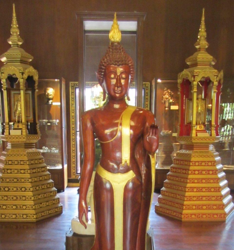 Wooden standing Buddha